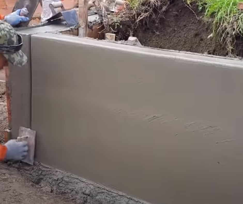 Concrete retaining wall being constructed